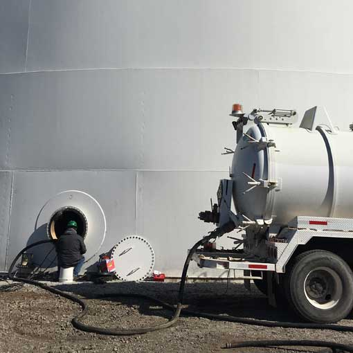 Image of Liquid phase vacuum truck at work by Spike Enterprise